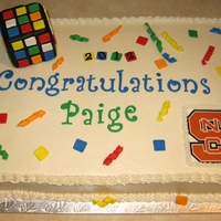 Paige Half-sheet red velvet with cream cheese filling and vanilla buttercream. Rubik's Cube made from RTK. School logo made on my home...