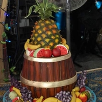 Fruit Barrel   Barrel is fruit cake on the bottom and vanilla coconut cake on the upper half,pineapple is fruit cake, fruits are gumpaste.TFL,