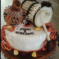 Yoruba Traditional Wedding Cake Talking Drum Is Vanilla Coconut Cake While Base And Calabash Is Fruit Cake Every Other Thing On The Cake I... Yoruba traditional wedding cake. Talking drum is vanilla coconut cake while base and calabash is fruit cake, Every other thing on the cake...