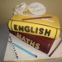 Teacher's Birthday Bottom book was fruit cake while upper book was vanilla cake, pencils,ruler,plaque and flower are all gumpaste.