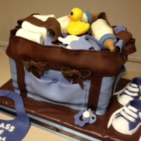 Diaper Bag Cake Duck, pacifier, bottles,bib, diapers, shoes and bag...also elephants on a ring.