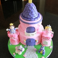 Fisher Price Castle First Birthday cake. Fisher Price Castle and figures. Everything is handmade and edible!