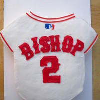 Baseball Jersey Birthday Cake This was made for a 2-year-old's birthday party. It was iced all in buttercream. The MLB logo is made of fondant and the stripes...