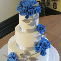 Sapphire Roses And Silver Leaves. Lemon rasp cake, iced with white choc ganache, MFF. Sapphire blue gumpaste roses, silver leaves