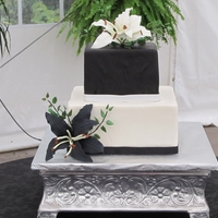Black And White Square Wedding Cake Black and white square cake with gumpaste lilies.