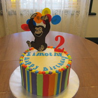 Curious George Birthday Cake Orange cake with lemon curd and white chocolate mousse filling. Iced with SMBC and MFF accents. George is chocolate run out. Letters are...