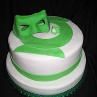 Green Lantern This cake I did for a friends Birthday It is a Green Lantern cake the mask and ring are made of fondant it's a yellow cake covered in...