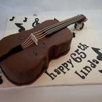 Cello Cake For My Aunt Vanilla Cake With Chocolate Ganache Covered In Duffs Chocolate Fondant My First Carved Cake Cello cake for my Aunt. Vanilla cake with chocolate ganache covered in Duff's chocolate fondant. My first carved cake.