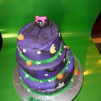 Halloween Birthday My daughter's 5th birthday. First time using chocolate ganache under the fondant.