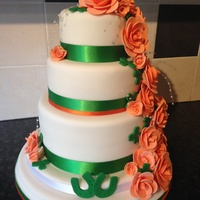Iris He Themed Sponge Wedding Cake Bottom Tier Of The Sponge Is Coloured In The Irish Flag Colours Iris he themed sponge wedding cake, bottom tier of the sponge is coloured in the Irish flag colours.