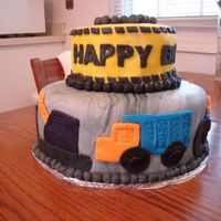 Alex's Construction Cake  For my nephew...I tried to make the top tier resemble caution tape and the bottom resemble granite- I'm anxious to know if you think I...