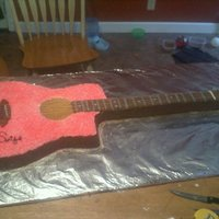 Life Sz. Guitar Cake  Life Sz. Taylor Swift Autographed Guitar Cake. made from two 1/2 sheet & one 1/4 sheet cake pans, then carved and iced in buttercream w...