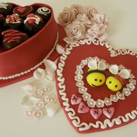 "Bee Mine ""Bee Mine"" Valentine's Day cake. Candy box is chocolate cake covered in fondant. Candy inside the box are cake balls covered..."