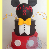 Master Of Ceremony Mickey Mouse Cake Topper cake is fondant over butter cream using my wrapping technique to get sharp edges and bottom is all buttercream. topper is Styrofoam...