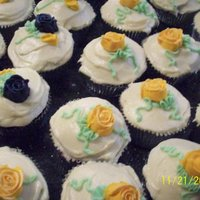 Wedding Cupcakes These were for a friend's daughter's wedding. The colors were dark blue and goldenrod yellow.