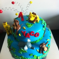 Wild Cake   all the decoration and figurines made out of fondant. Had lots of fun with this one!Thank you for looking!