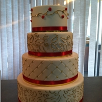 Gold 4 tier gold and red wedding cake lots of work but so worth it...