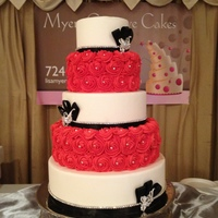 Rosette Cake 5 tier white fondant and red buttercream rosettes with rhinestone accents and trim... Show cake!