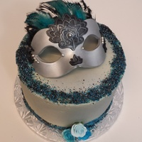 "Masquerade Mask Cake Was The Centerpiece Around Cupcakes 8X4 Vanilla Cake Filled And Covered With White Chocolate Ganache Airbrushed Si Masquerade Mask Cake - Was the centerpiece around cupcakes8""X4"" vanilla cake filled and covered with white chocolate ganache..."