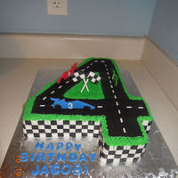 Race Track Cake fondant road, checkers, and little cars.