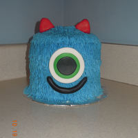 Monster Cake smash cake for a first birthday. butter cream with fondant eye, mouth, and horns