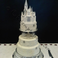 Snowflake Castle Wedding Cake The castle was handmade from pastillage and the delicate snowflakes were hand piped with sugarveil.