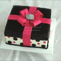 Black & Pink Gift Box Bow and brooch are gum paste, brooch is painted with NuSilver mixed with Everclear. Lid & dots are fondant over buttercream icing.