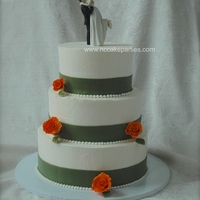 Orange Roses Brides colors, she requested small single roses on sides of cake. Whipped buttercream icing.