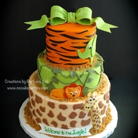 Jungle Baby Shower Dark chocolate cake, peanut butter mousse filling. Buttercream icing, fondant details/figures.