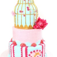 Birdcage Wedding Cake   wedding cake with birdcage in blue and pink.