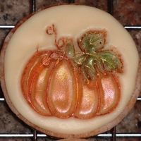 Pumpkin Cookie Shortbread cookie with white chocolate fondant, painted with luster dust