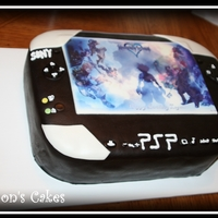Psp two layer sheet cake with black fondant and an edible image.