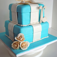 Sweet 16 Tiffany Cake White cake with Lemon filling8 inch and 6 inch squareVanilla fondant with gum paste accents