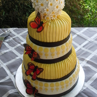 Yellow Modern Wedding Cake  This is not my design. The bride brought me a picture torn from a magazine that was originally done in all fondant. I duplicated to the...