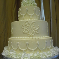 Wedding Jewelry Cake  3 tiers of yellow cake with raspberyy filling and IMBC icing. The top and bottom tiers are decorated to look like the jewelry the bride...