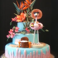 Flamingo At The Beach With Beautiful Realistic Looking Tropical Gumpaste Flowers Flamingo at the beach with beautiful realistic looking tropical gumpaste flowers.