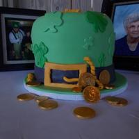 Irish Groom Peanut butter cake with white chocolate buttercream frosting, mmf covered leprechaun's hat. Chocolate coins were purchased.