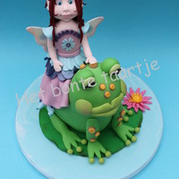 Frog Fairy The Frog Is A 3D Cake With A Sugarpaste Fairy On His Back Frog fairy.The frog is a 3d cake with a sugarpaste fairy on his back!
