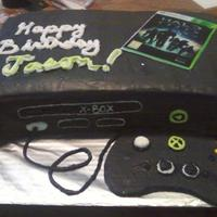 Xbox Wanted to try this xbox cake order in black. For a 13 yr old boy named Jason =) Cake is marble with buttercream and MMF (edible pic of xbox...