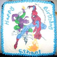 "Spidey And The Green Goblin 10"" square cake with butter cream icing. Picture is traced in chocolate."