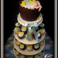 Washtub And Ducklings Idea came from a photo from Flickr. I would like to thank Melanie for the inspiration. The new mother to be loved the cupcake tower and so...
