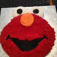 Elmo Eyes and mouth are fondant, nose is candy melts, the rest is buttercream.