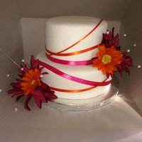 Pink/orange Last Minute Wedding This was a last minute order for a last minute wedding. White fondant, pink/orange ribbon and flowers.
