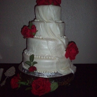 Savannah's Wedding Cake marshmallow over buttercream, fondant/gumpaste drape