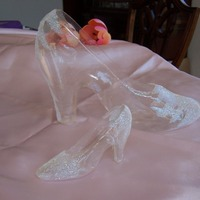 "Gelatin Slippers For Cinderella Pillow Cake I did 2 gelatin 'glass' slippers. The larger one is about 8"". Trying to decide which to put on my pillow cake. Done with..."