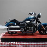 Fat Boy Harley Davidson Cake  Birthday cake for owner of a Harley dealership. Cake feed 200, chocolate with rasp filling and white with lemon filling. Cake is 3 1/2 fee...