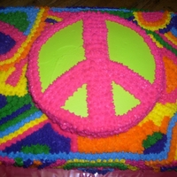 Peace!! This a 11x15, 1/2 yellow, 1/2 chocolate cake.. The top peace sign is an 8 inch chocolate cake.. The bottom cake was inspired by: eastercand...