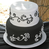 Black And White Cake  Scrolling done with royal icing, accented with silver dragees (for decoration purposes only). This was the cake after a photo board fell on...