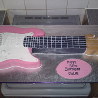Pink Electric Guitar Cake so a big cake!! had to make the board myself as the local cake shop was a no go for my requirements! was fun to do and although i didnt do...