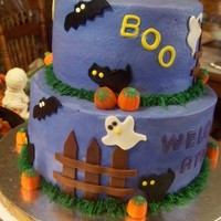 "Halloween Baby Shower  This is a 8"" and 6"" marble cake..... loved this idea for a baby shower..... the cake is iced in buttercream and fondant accents..."